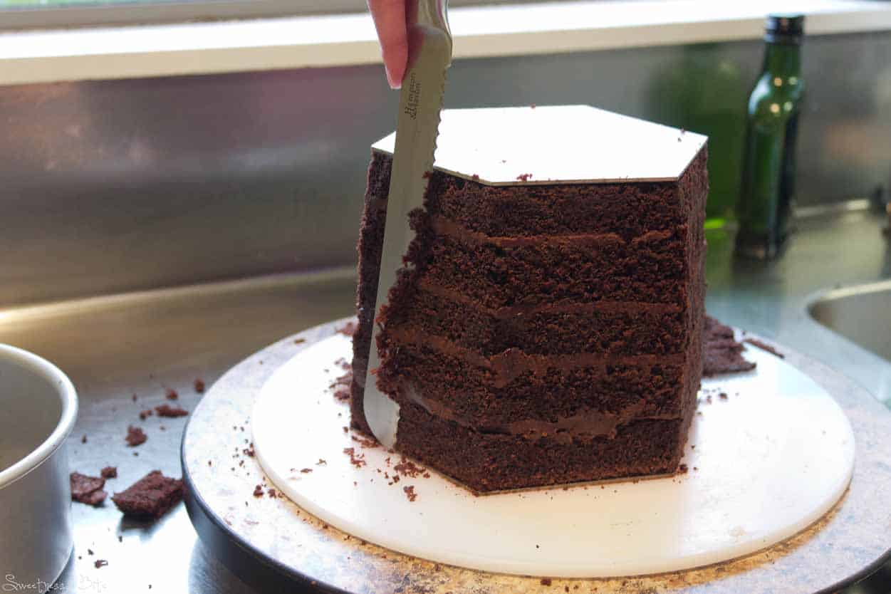 Keep scraping away the cake til the sides are smooth.
