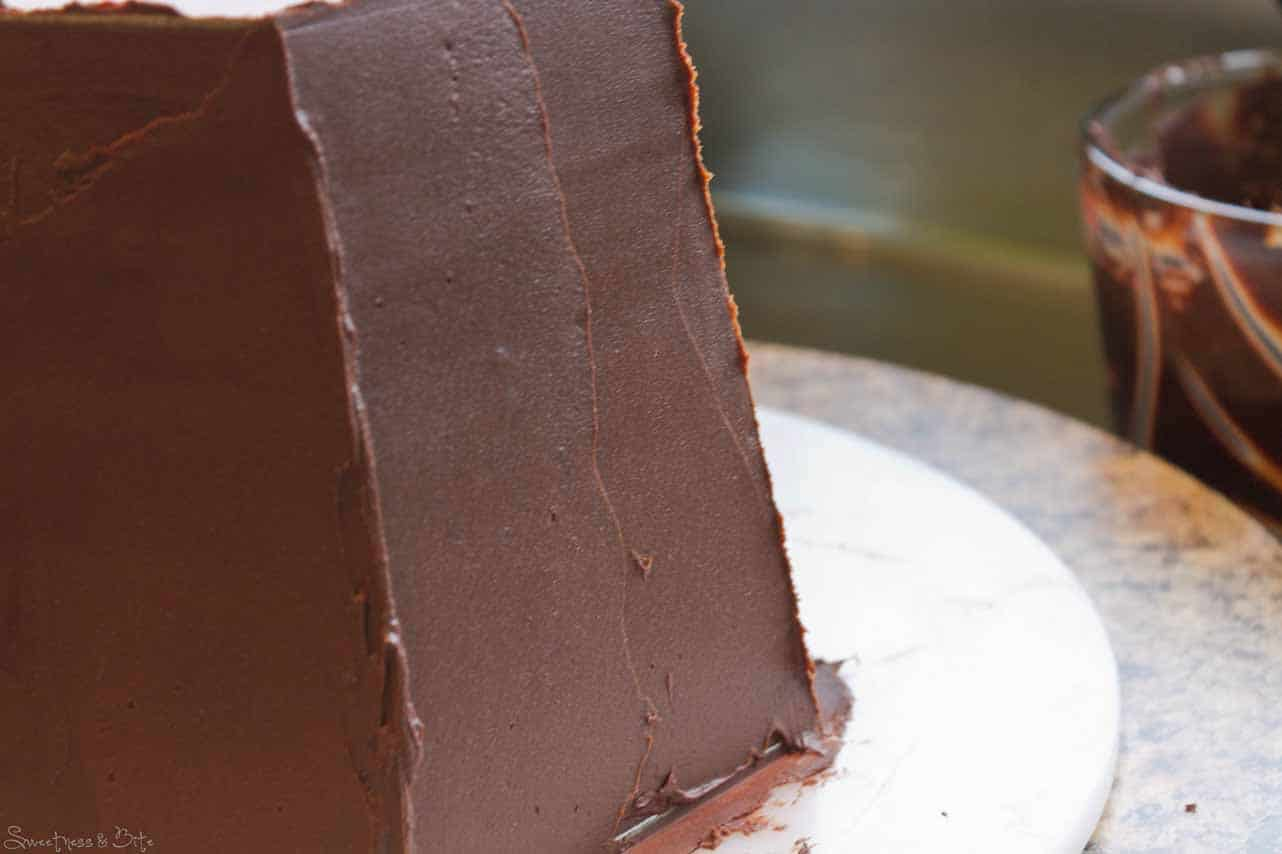 Keep adding ganache, then begin scraping the sides.