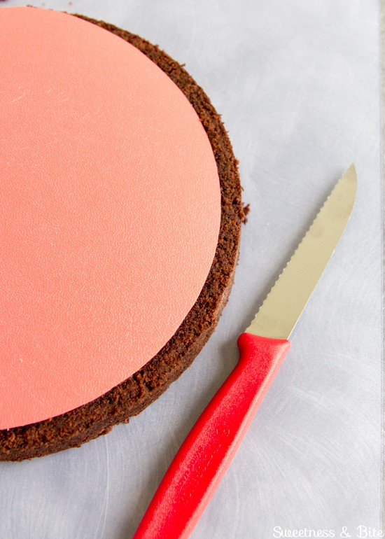 Trimming the cake layers with a small serrated knife.