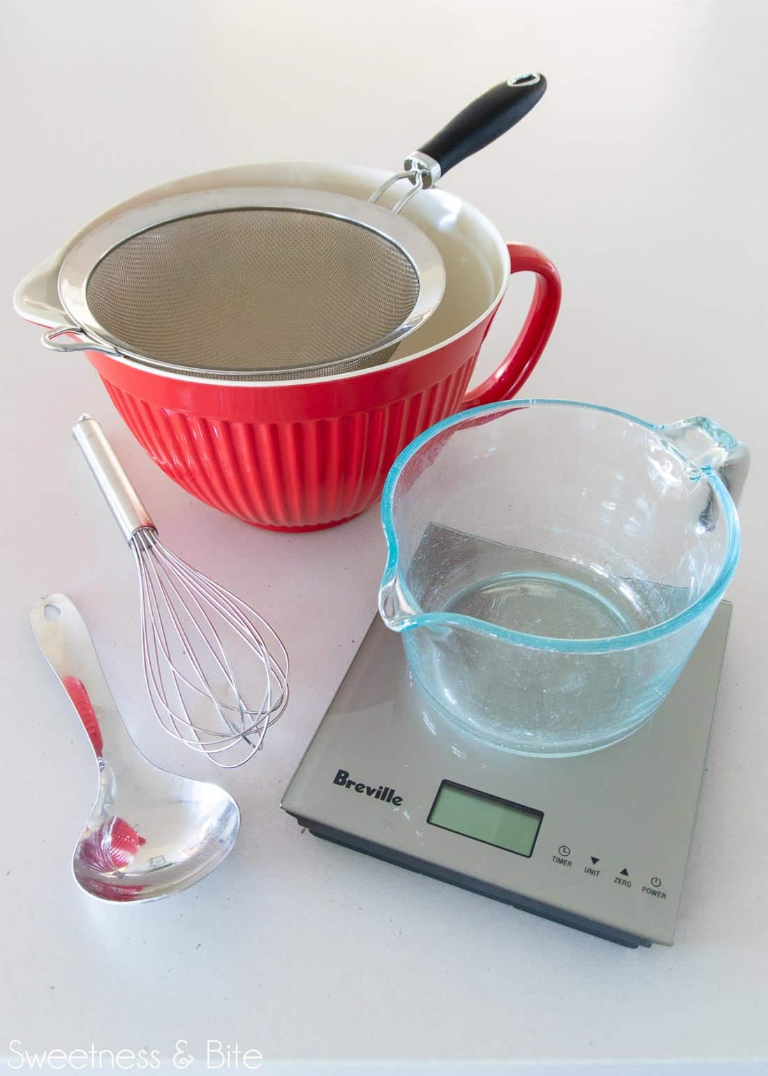 Tools for mixing up the flour blend - bowls, sieve, spoon, whisk and kitchen scales.