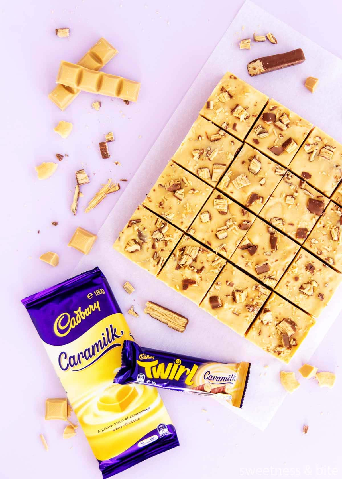 16 squares of slice, with a wrapped block of Caramilk chocolate and a Caramilk Twirl.