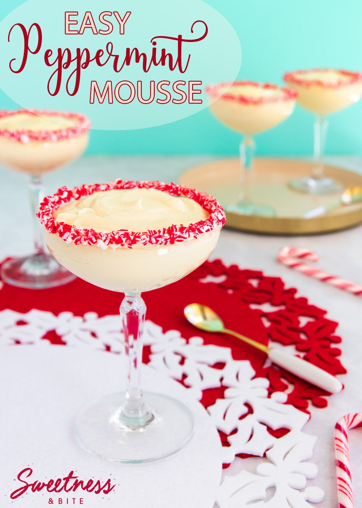 Easy peppermint mousse served in a cocktail glass, with crushed candy canes around the rim of the glass.