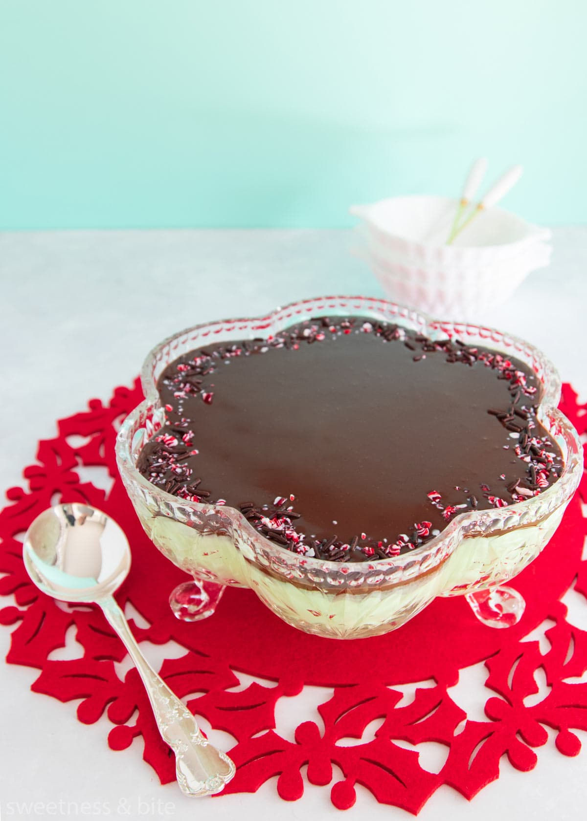 Mint mousse in a flower shaped cut glass bowl, topped with dark chocolate ganache and crushed candy canes.