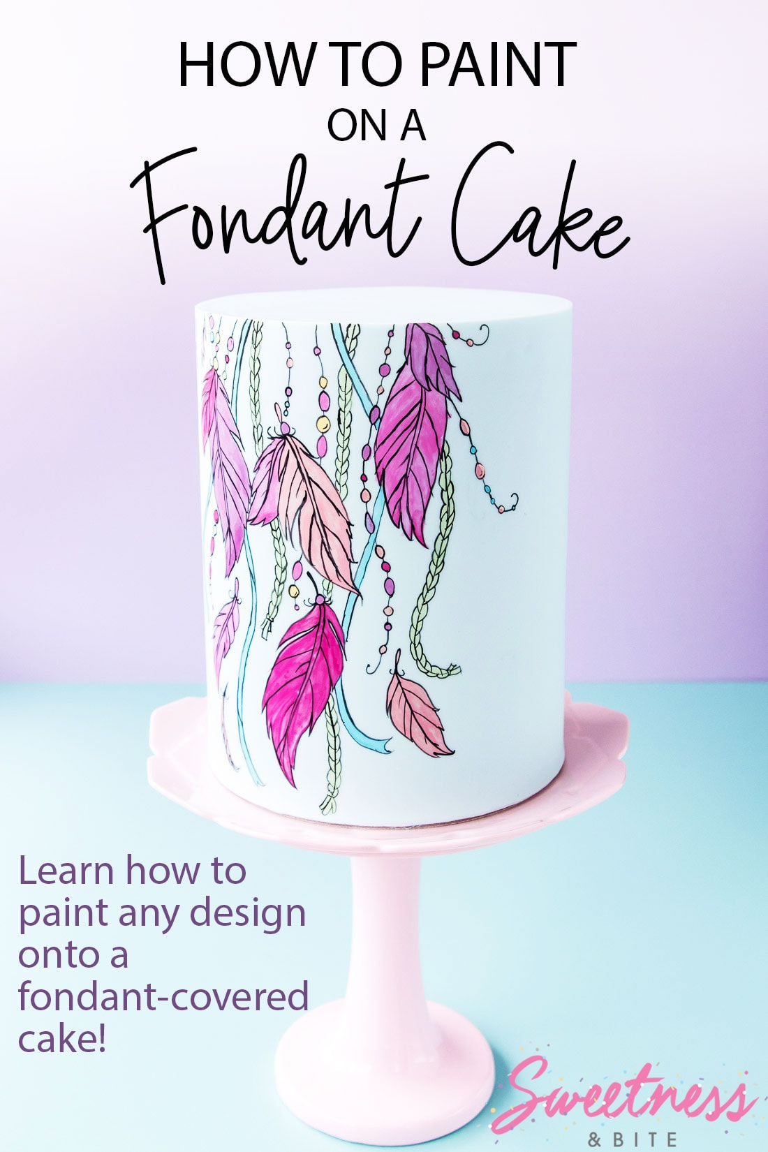 A pale blue fondant-covered cake with a bright dreamcatcher design painted on the front. Text overlay reads: