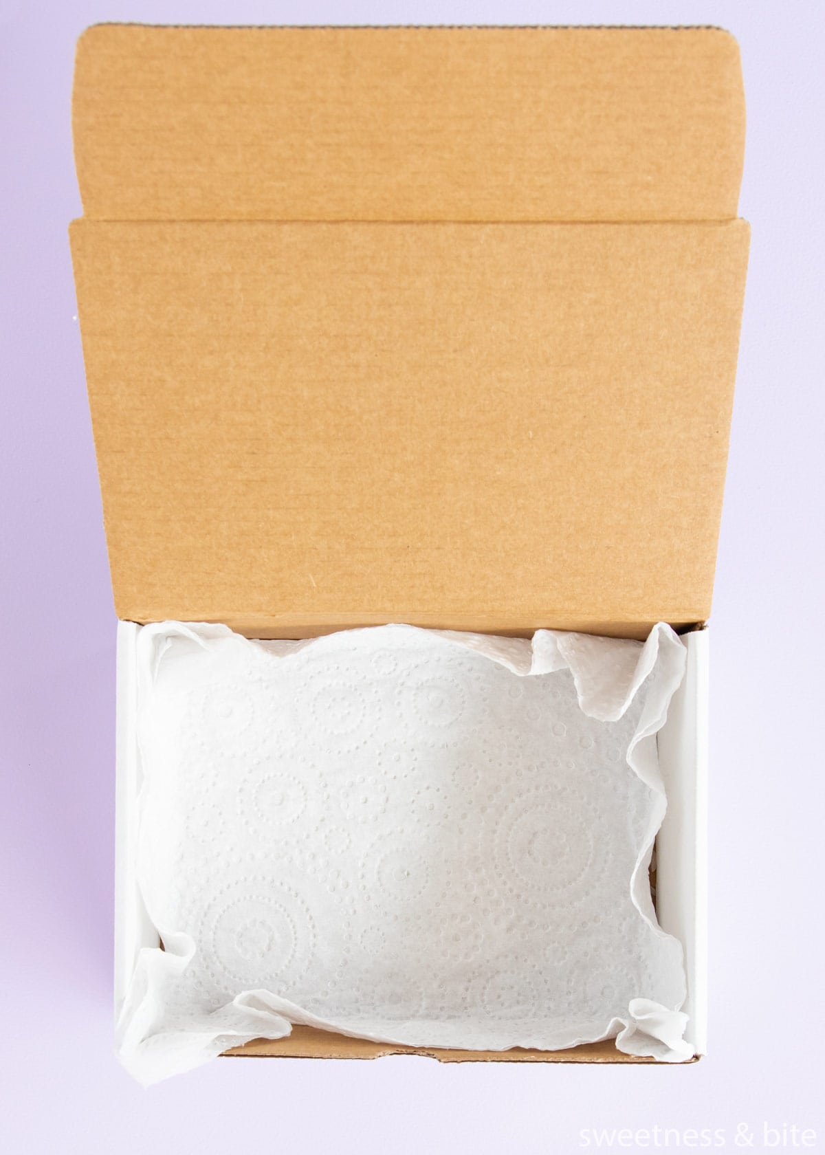 A box lined with a paper towel.